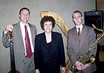 Rob Henson on bass and Will Scruggs on saxophone and Susan on jazz harp played for a High Museum fund raiser. 5/15/06